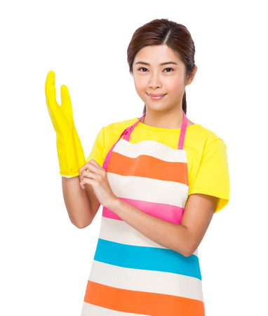 Housewife wear plastic gloves photo