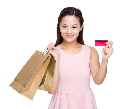Woman with a shopping bag and credit card photo