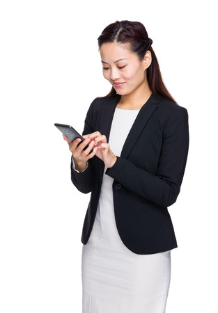 Asian businesswoman use mobile phone photo