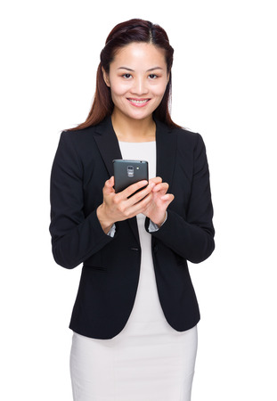 Asian businesswoman use a mobile phone photo