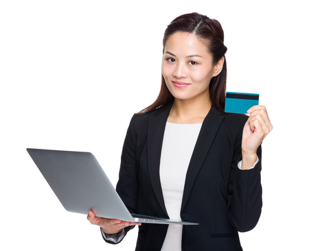 Asian businesswoman with a laptop and credit card photo
