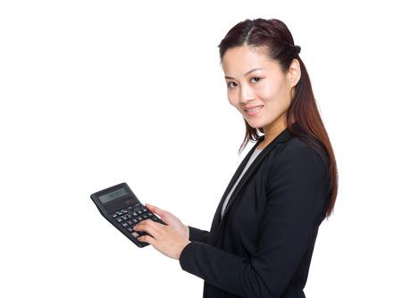 Asian businesswoman use a calculator photo