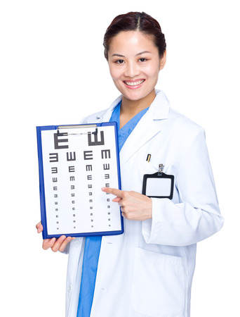 Optical woman doctor finger point to eye chart photo