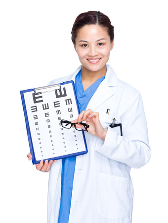 Woman Optician hold an eye chart and glasses photo
