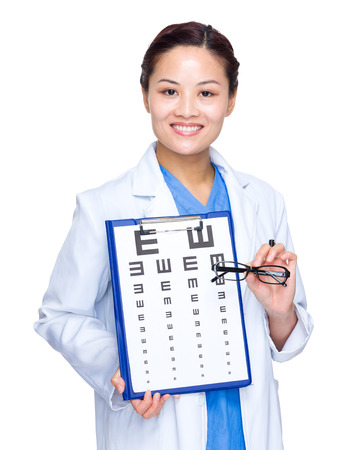 Woman Optical doctor with eye chart and glasses photo