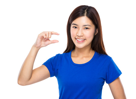 Woman with finger show small distance photo