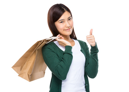 Woman with shopping bag and thumb up 版權商用圖片