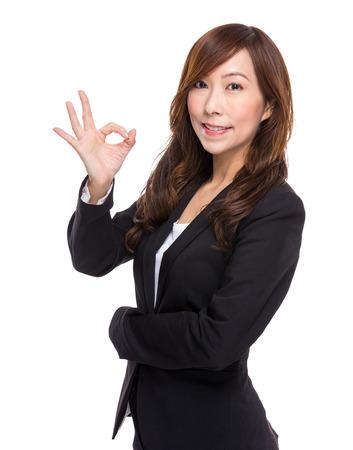 Senior businesswoman with ok sign