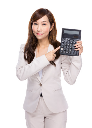 Asian businesswoman use of calculator photo