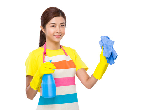 chinese people: Asian housewife use spray and towel Stock Photo