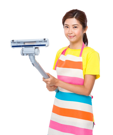 Housewife hold dust vacuum photo
