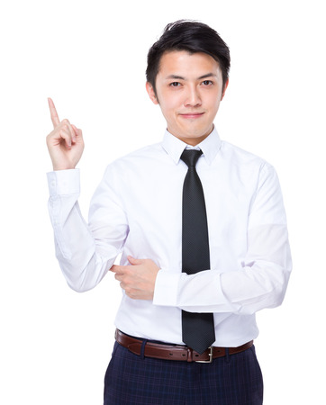 Business man finger point up photo