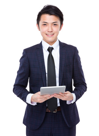 Young Businessman touch on tablet photo