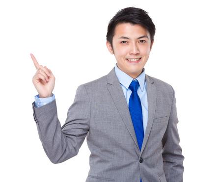 Businessman finger point up photo