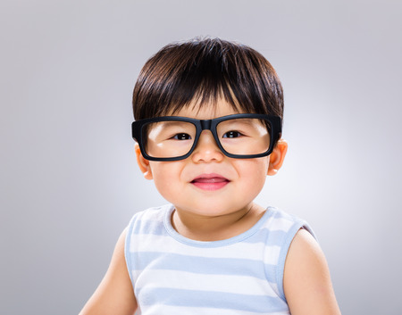 Smiling baby with eye wear photo