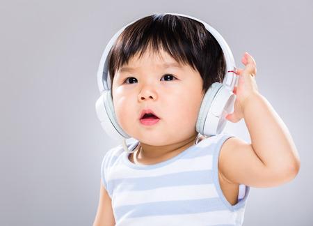 Baby boy wear headphone photo
