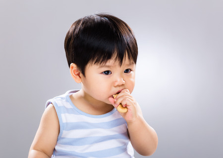 Baby eat finger food Stock Photo