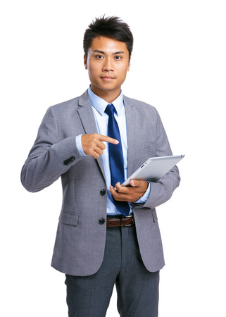 Businessman finger point to digital tablet photo