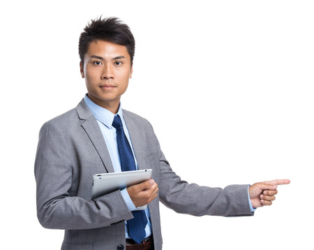 Businessman with digital tablet and finger point aside photo