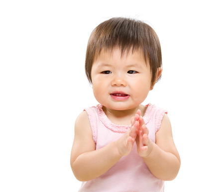 Asian baby girl clapping hand photo
