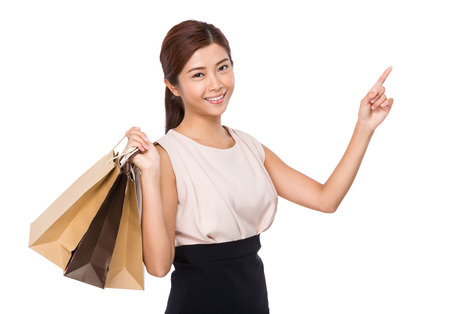chinese people: Happy woman with shopping bag and finger up Stock Photo