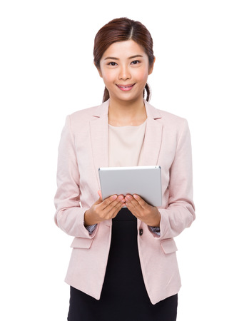 Asian businesswoman use tablet photo