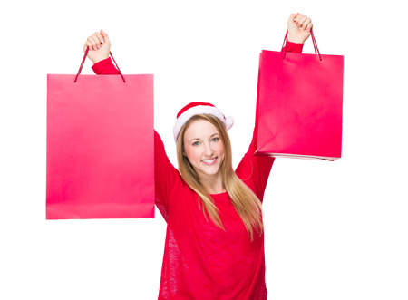 hold up: Woman with Christmas hat and hold up the paper bag Stock Photo