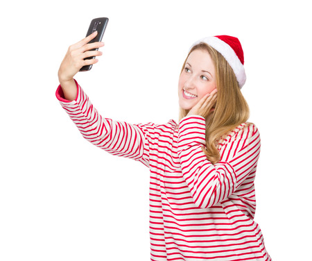 Woman with red hat and take selfie photo