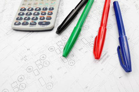 Architectural blueprint and calculator photo