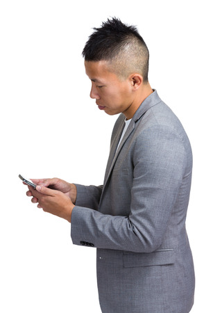Business man look at mobile photo