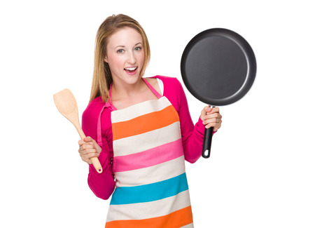 hold up: Housewife hold up with pan and wooden spatula