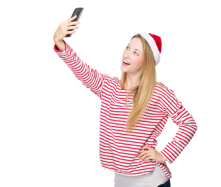 Woman with xmas hat and take selfie photo