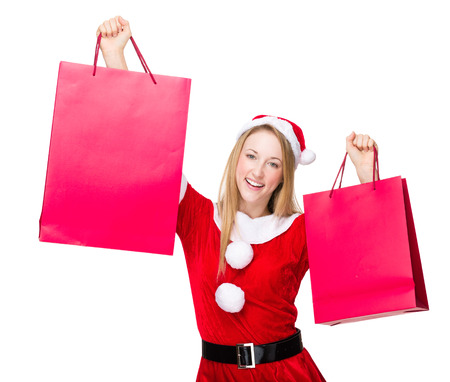 hold up: Woman with christmas party dress and hold up with shopping bag