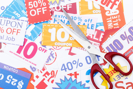 penny pinching: Money saving coupon vouchers with scissors