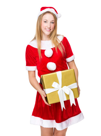 Woman with santa dressing and holding present box photo