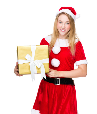 Christmas woman and hold with big golden gift box photo