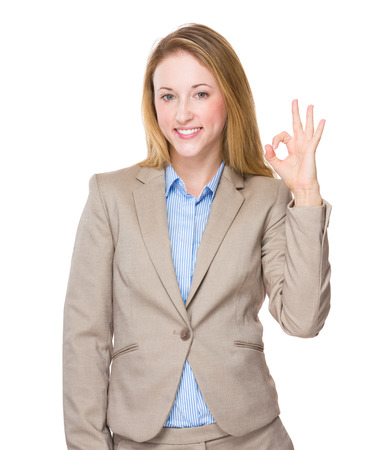 Businesswoman with ok sign photo