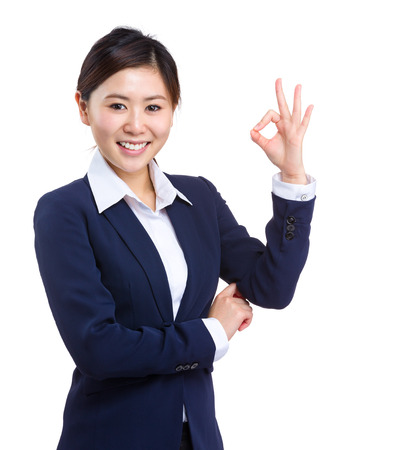 Business woman with ok sign photo