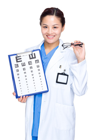 Optical woman doctor with eye chart and glasses photo