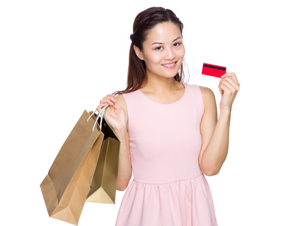 Woman with shopping bag and credit card photo