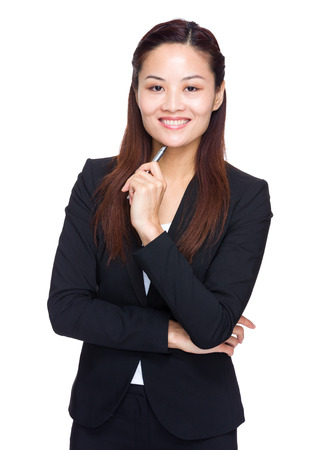 Asian businesswoman with pen up photo