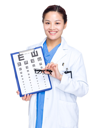 Optical doctor hold with eye chart and glasses photo