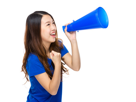 clench: Happy woman yell with megaphone Stock Photo