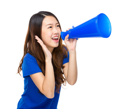 Young woman yell with megaphone photo