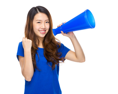 Happy girl hold with megaphone photo