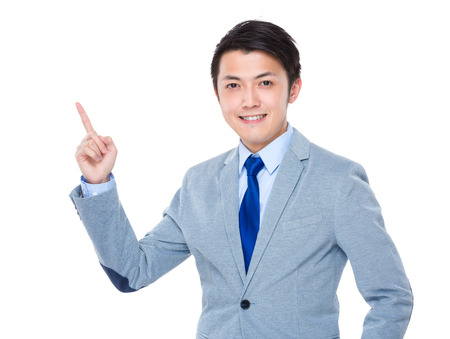 Businessman with finger point up photo