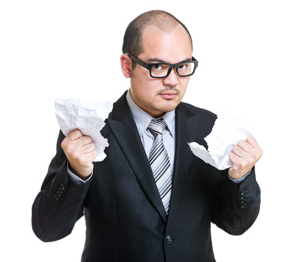 angry businessman: Angry businessman tear paper Stock Photo