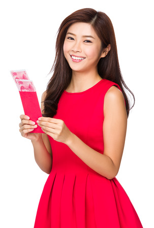 unwrapped: Woman with unwrapped chinese red pocket Stock Photo