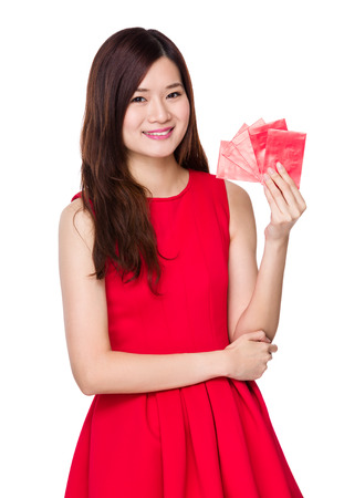 Asian woman hold with red pocket money photo
