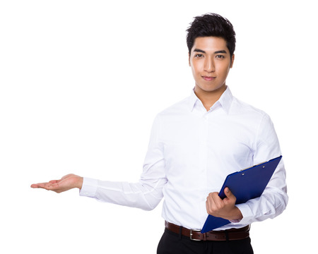Businessman with clipboard and open hand palm